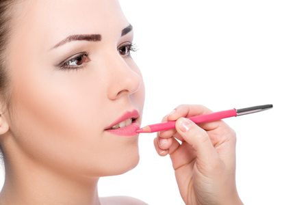 lip pencil: Professional Make-up. Makeup.  lip pencil. woman applying lipstick on lips with pencil