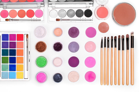 lip pencil: set of cosmetics: eye shadow, lipstick, mascara, powder, lip pencil, Foundation, makeup brushes. top view