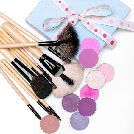 copyspace: set of cosmetics: makeup brushes and multicolored eyeshadow Stock Photo