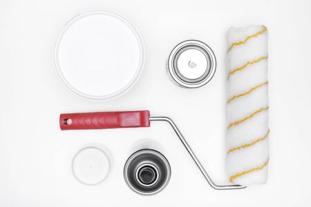 paintroller: the tools of a painter: paint,  paint-roller on white background, top view