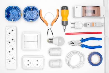 electrical equipment and tools on white background. the view from the top Standard-Bild