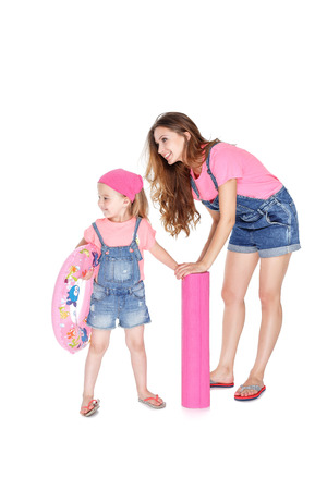 beach mat: happy family going to the beach. beautiful mom and lovely daughter with a pink rubber ring and  beach Mat Stock Photo