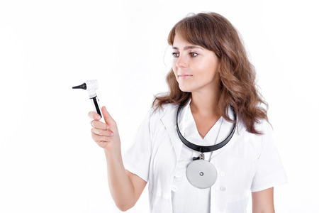 Doctor ENT is holding the Otoscope. Otolaryngologist in white coat