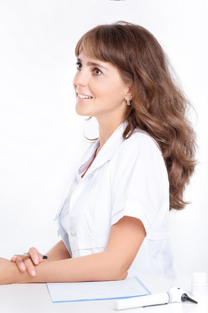 woman doctor ENT with frontal reflector Stock Photo