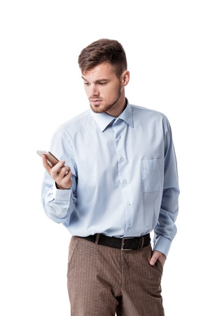 business skeptical: Portrait of businessman in doubt, skeptical and looks at the phone, isolated on white background