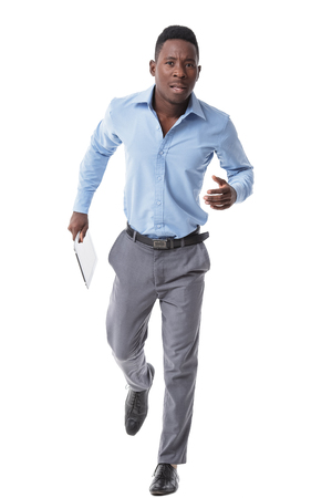 African-American business man running  with tablet, isolated over white background Standard-Bild