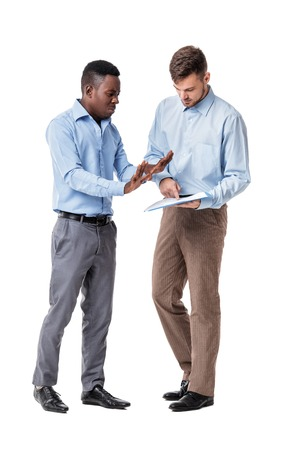 disadvantage: African-American and Caucasian businessman discussing a contract and a quarrel on a white background. a disadvantage Stock Photo
