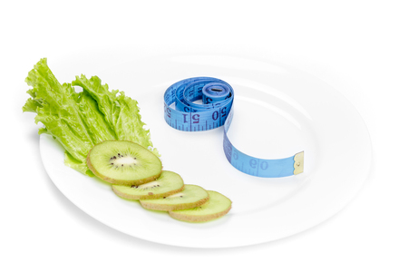 depth measurement: healthy eating, diet and weight loss, detox. measuring tape and fresh kiwi