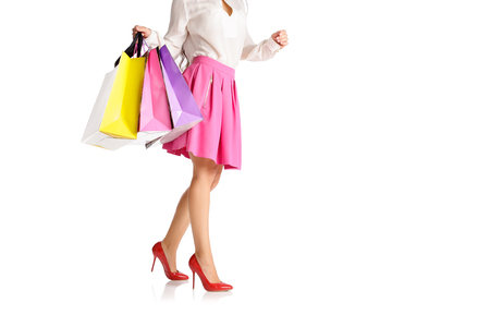 or spree: people, sale, black friday concept - woman with shopping bags isolated on white background Stock Photo