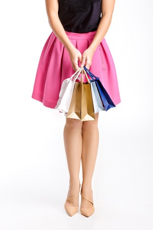 people, sale, black friday concept - woman with shopping bags isolated on white background Stock Photo