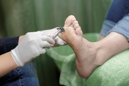 Pedicure  procedure in the beauty salon.  emover calluses on the feet. Foot care. Stock Photo