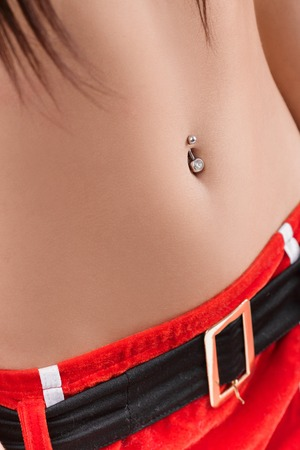 naked young teenage girl: abdomen Femme avec piercing au nombril