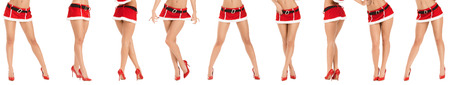 Beautiful legs of young and sporty woman wearing santa claus clothes isolated on white background.