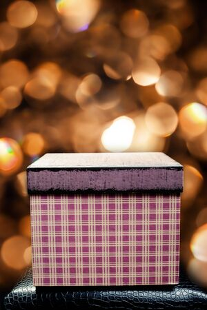 red Christmas gift box on bokeh background Stock Photo