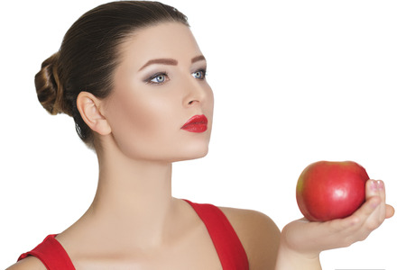 vitamine: woman holding a dark red Apple. healthy eating Stock Photo