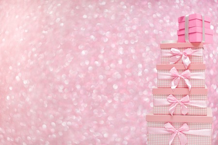 gift boxes with satin ribbons on bokeh background.