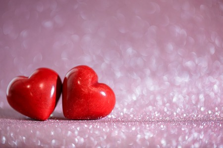 Valentines day red hearts on a beautiful bokeh background.