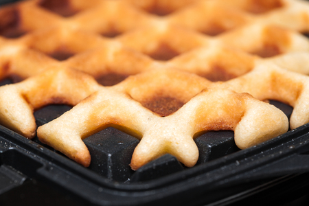 browned: waffles are cooked in waffle iron