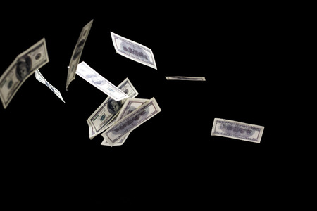 us paper currency: hundred dollars banknotes fly on black background. money rain concept