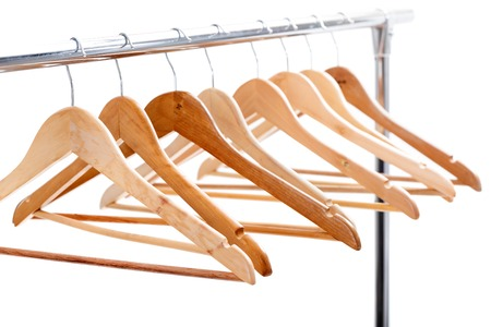 clothing rack: wooden empty hangers for clothes on rack on white background. no Stock Photo