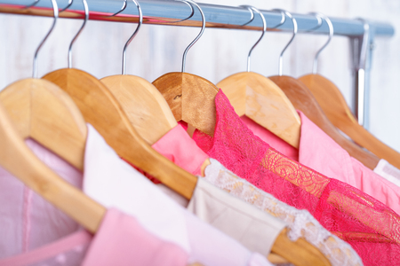 blouses: pink womens clothes on hangers on rack in fashion store. closet Stock Photo