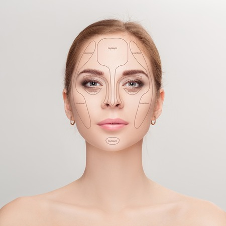 blend: Contouring. Make up woman face on grey background.  Professional