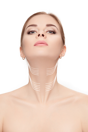 woman with arrows on face over white background. neck lifting co 스톡 콘텐츠