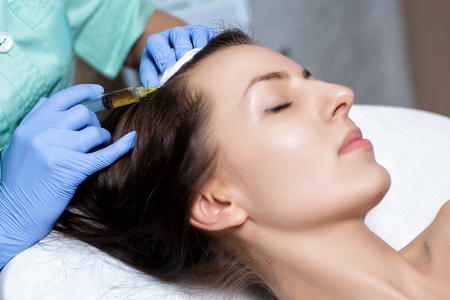 Needle mesotherapy. Cosmetic been injected in womans head. to s Stock Photo