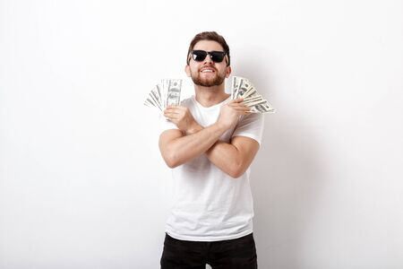 handsome smiling man with beard in shirt and sunglasses holding