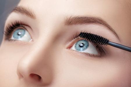 Mascara brush close up.  Make-up for blue eyes. Mascara applying