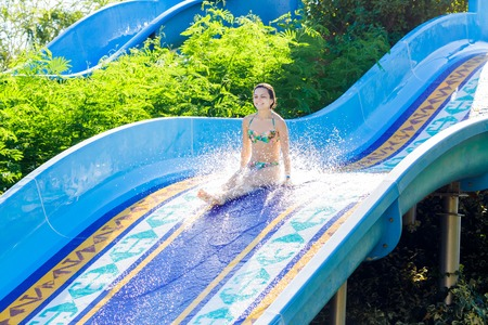 woman going down a water slide 스톡 콘텐츠