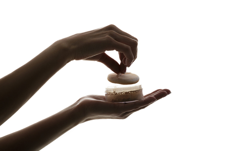 silhouette of female hands holding face powder isolated on white background Stock Photo