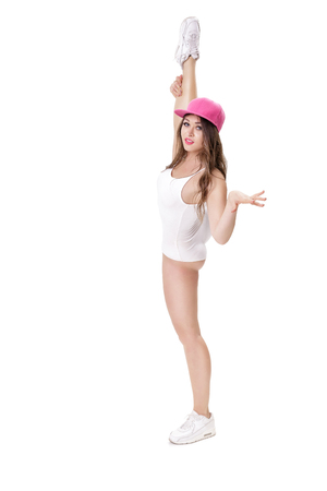 young athletic and flexible woman doing standing splits on white background