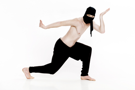Ninja on white background. Male fighter in black clothes