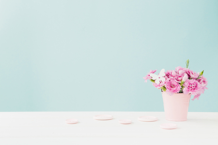 bouquet of pink Carnation flowers in vase on pink background. Empty space for text