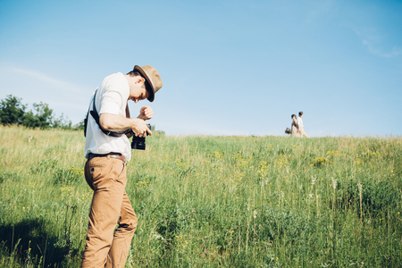 wedding photographer takes pictures of bride and groom in nature, fine art photo Stock Photo