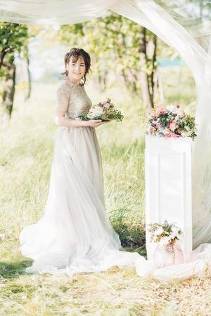 fineart: bride holding  wedding cake. wedding cake decorated with flowers Stock Photo