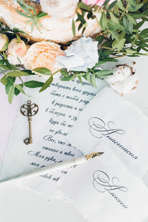 Invitations to wedding, key and flowers