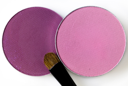 round pink eye shadow and makeup brush on the  white background