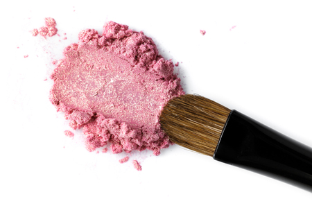 Broken pink eye shadow and brush isolated on white background