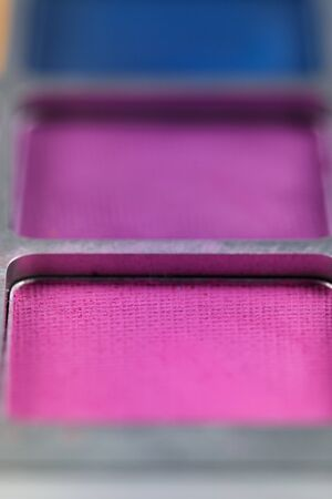pallet of colored eye shadows, texture. Shallow depth of field