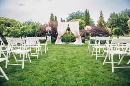 Arch and chairs for the wedding ceremony