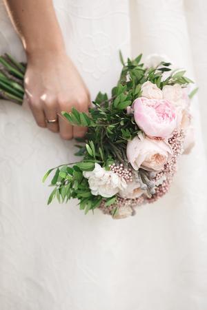 bride holds beautiful wedding bouquet