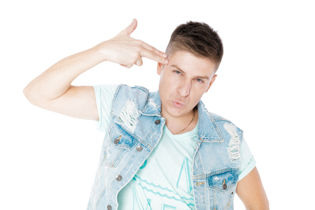 young man in denim isolated white background Stock Photo