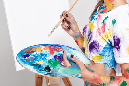 female artist holding  palette with paints for drawing Stock Photo