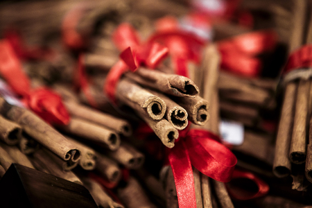 cinnamon sticks with red ribbons