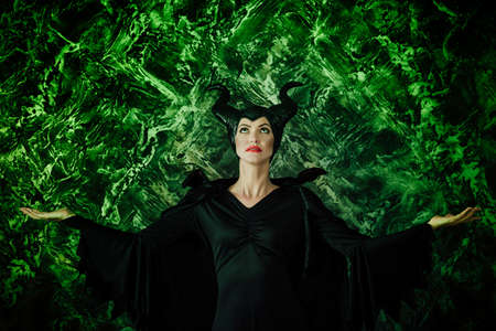 beautiful woman dressed as Maleficent Banco de Imagens - 87849057
