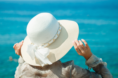 attractive woman in a white hat Stock Photo