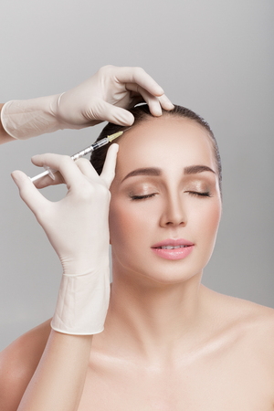 Cosmetic been injected in womans head. Stock Photo