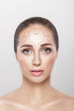 Make up woman face on grey background.